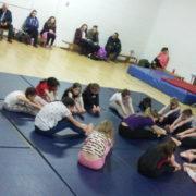 Connie taking the gymnasts through a good stretch